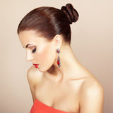 Portrait of beautiful brunette woman with earring. Perfect makeup royalty free stock images