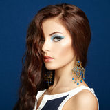 Portrait of beautiful brunette woman with earring. Perfect makeu Stock Image
