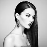 Portrait of beautiful brunette woman with earring. Perfect makeu Royalty Free Stock Photos
