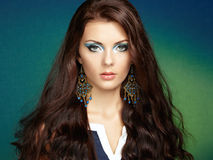 Portrait of beautiful brunette woman with earring.   Royalty Free Stock Photo