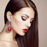 Portrait of beautiful brunette woman with earring Stock Photos
