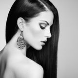 Portrait of beautiful brunette woman with earring Stock Photo
