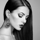 Portrait of beautiful brunette woman with earring Royalty Free Stock Image