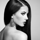 Portrait of beautiful brunette woman with earring Royalty Free Stock Photography