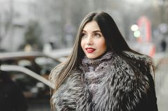 Portrait of beautiful brunette Woman in fur having fun Royalty Free Stock Images