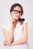Portrait of beautiful brunette woman in glasses Stock Photography