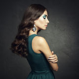 Portrait of beautiful brunette woman in green dress Stock Images
