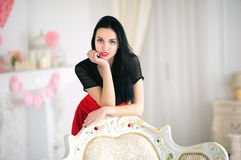 Portrait of a beautiful brunette woman leaning on Stock Photography