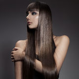 Portrait of a beautiful brunette woman with long straight hair Stock Photography