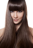 Portrait of a beautiful brunette woman with long straight hair Royalty Free Stock Images