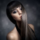 Portrait of a beautiful brunette woman with long straight hair Stock Image