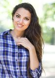Portrait of beautiful brunette woman looking at camera Stock Photography