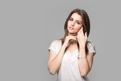 Portrait of beautiful brunette woman with natural make-up, on grey background Royalty Free Stock Image