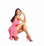 Portrait of beautiful brunette woman in pink dress. Fashion photo Stock Photo