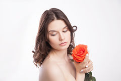 Portrait of beautiful brunette woman with red rose Stock Photos