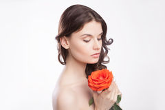 Portrait of beautiful brunette woman with red rose Royalty Free Stock Image