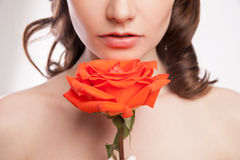 Portrait of beautiful brunette woman with red rose Stock Photography