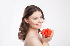 Portrait of beautiful brunette woman with red rose Stock Photo