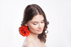 Portrait of beautiful brunette woman with red rose Stock Image