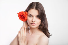 Portrait of beautiful brunette woman with red rose Royalty Free Stock Photos