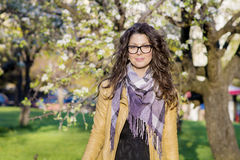 Portrait of beautiful brunette woman with  scarf in the park Stock Photo