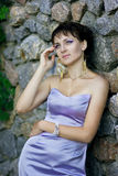 Portrait of a beautiful brunette woman. With short hair in evening dress Royalty Free Stock Images