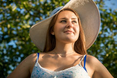 Portrait of beautiful brunette woman wearing hat at garden at su Stock Image