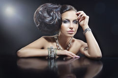 Portrait of beautiful brunette woman wearing jewellery Stock Images