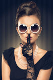 Portrait of beautiful brunette woman wearing pearl  jewelry. And sunglasses. retro style Stock Images