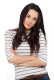Portrait of beautiful brunette woman wearing striped t-shirt. Over white background Royalty Free Stock Photos