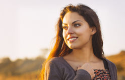 Portrait of the beautiful brunette woman at the windy autumn day Stock Photos