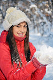 Portrait of beautiful brunette woman in the winter forest Royalty Free Stock Photos