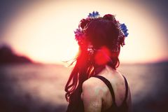 Woman with wreath. Portrait of a beautiful brunette woman with wreath in autumn outdoor stock image