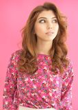 Portrait of beautiful young woman. Portrait of beautiful brunette young woman on pink background Stock Image