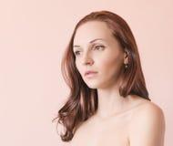 Portrait of a beautiful brunette. Stock Photos