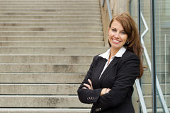 Portrait of a beautiful business woman with arms crossed - copys Stock Photography