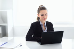 Portrait of beautiful business woman with laptop in the office Royalty Free Stock Images