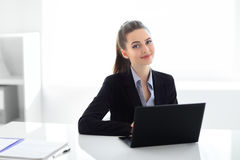 Portrait of beautiful business woman with laptop in the office Stock Photography