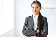 Portrait of beautiful business woman in the office Stock Image