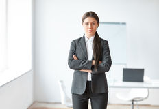 Portrait of beautiful business woman in the office Stock Images