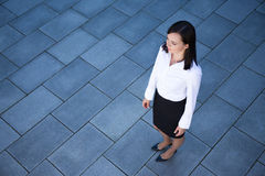 Portrait of beautiful business woman over tiled floor background Stock Image