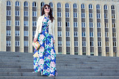 Portrait of beautiful business woman posing over big building Stock Photo