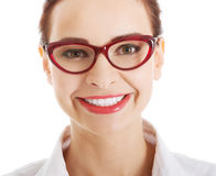 Portrait of beautiful business woman in red eyeglasses. Stock Image