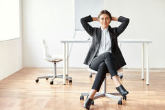 Portrait of beautiful business woman sitting on chair Royalty Free Stock Images