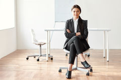 Portrait of beautiful business woman sitting on chair Stock Image