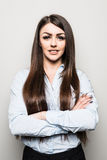 Portrait of a beautiful business woman standing with hands folded and looking at camera Royalty Free Stock Photography