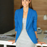 Portrait of a beautiful business woman standing near her workplace. Stock Photography
