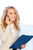 Portrait of beautiful business woman talking on cell phone Stock Images