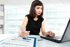 Business woman working on her desk Stock Photography