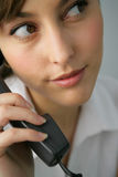 Portrait of a beautiful businesswoman. Talking on the phone Stock Images
